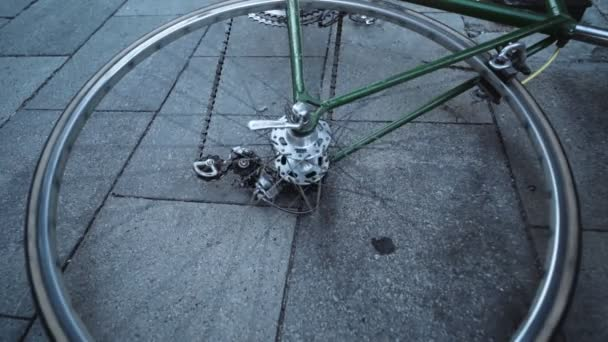 Spinning wheel of bicycle laying on ground