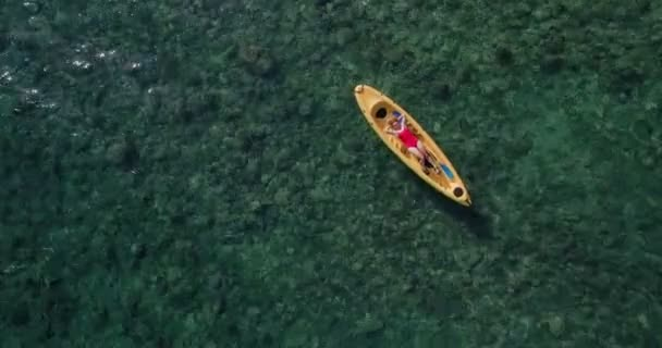 Drone footage of sexy woman in swimsuit on kayak