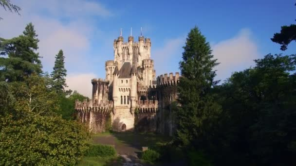 Aerial video of medieval tower in forest of rural spain