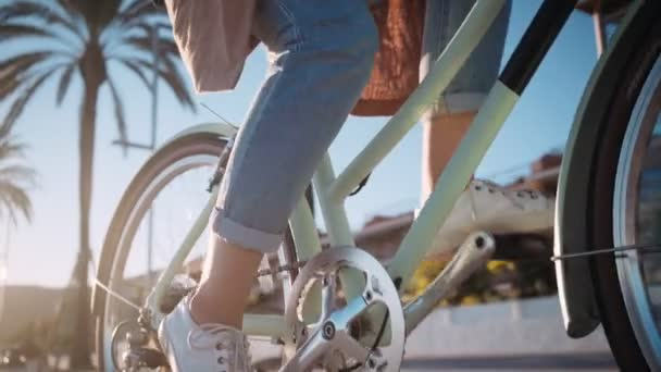 Girl is cycling in promenade