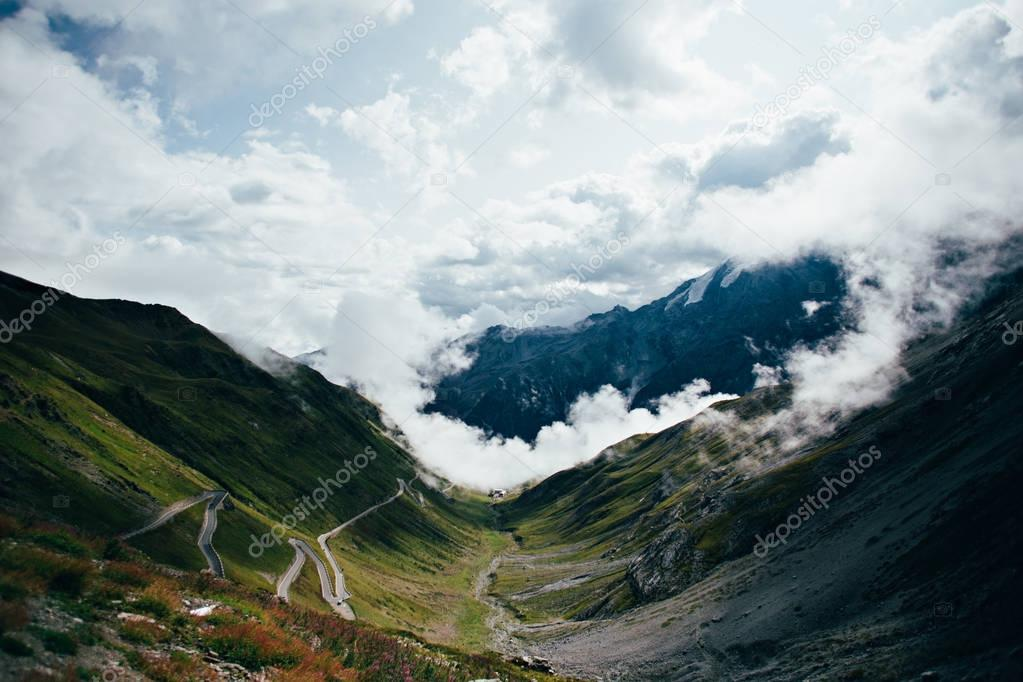 View on cloudy twisting road in mountains