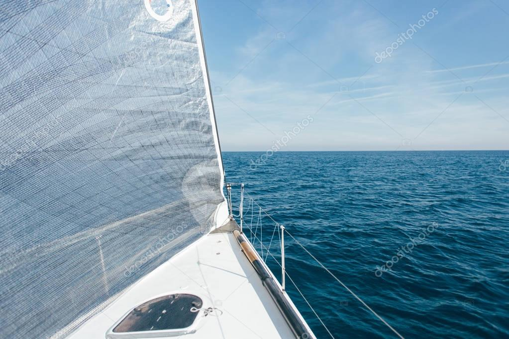 sailing yacht in blue ocean water