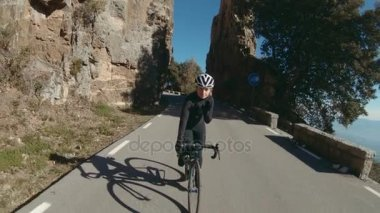 Girl rides her bicycle in mountains