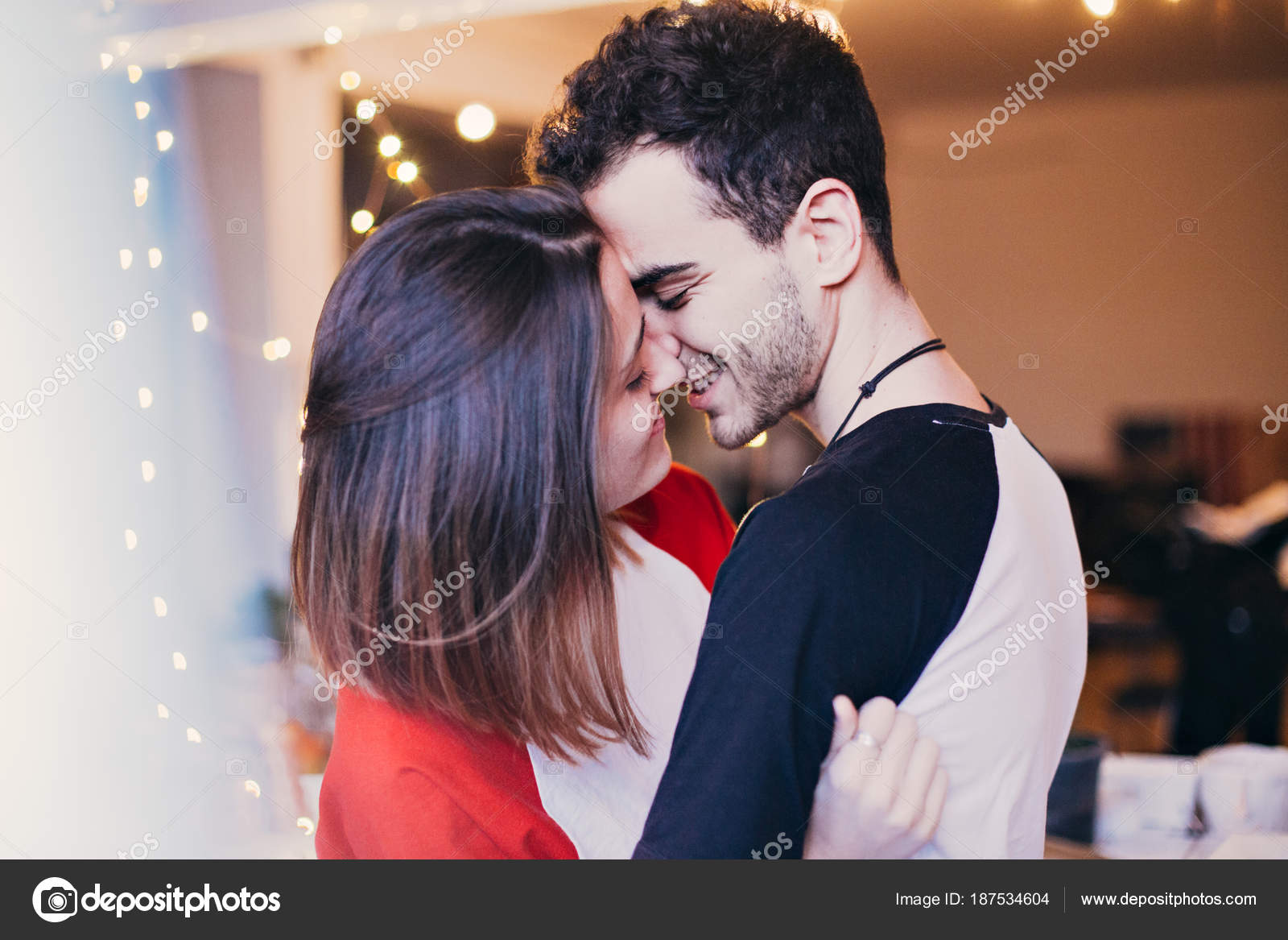 Cute sensual young couple love smiling hugging cuddling kissing cute and sensual young couple in love smiling hugging cuddling and kissing inside house or apartment teenagers or millennials truly in love with each altavistaventures Images