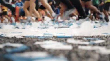 Marathon start finish line with confetti runners