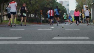 Marathon runners unrecognizable on city street