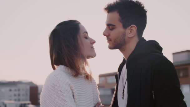 Portrait of young couple in sunset