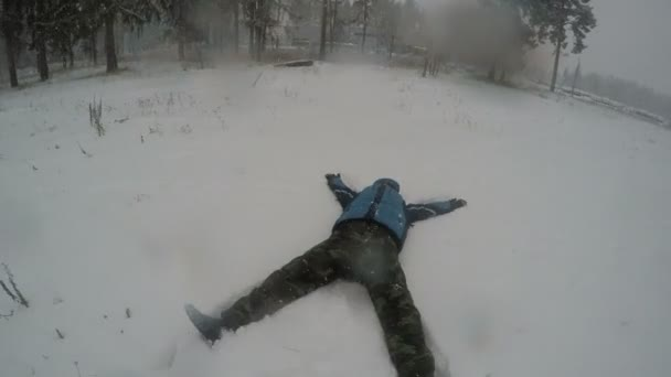 Man Falling Into Snow and Doing Snow Angel