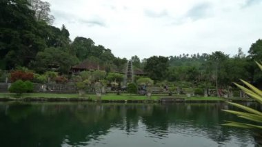 tirta ganga beautiful water palace green park in bali indonesia, fountain stream, wonderful nature landscape, place for meditation and relaxation