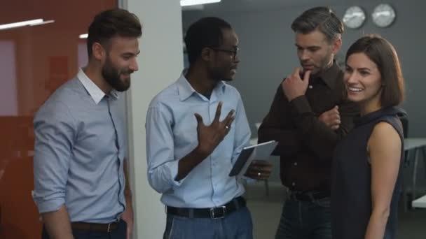 Four colleagues enjoying their success