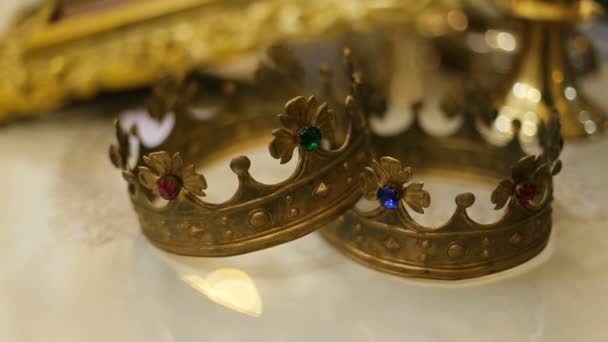 Close up of two wedding crowns prepared for ceremony of marriage in a church.