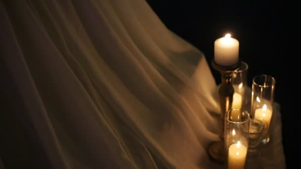 Burning wedding candles decorated on white and golden colors.