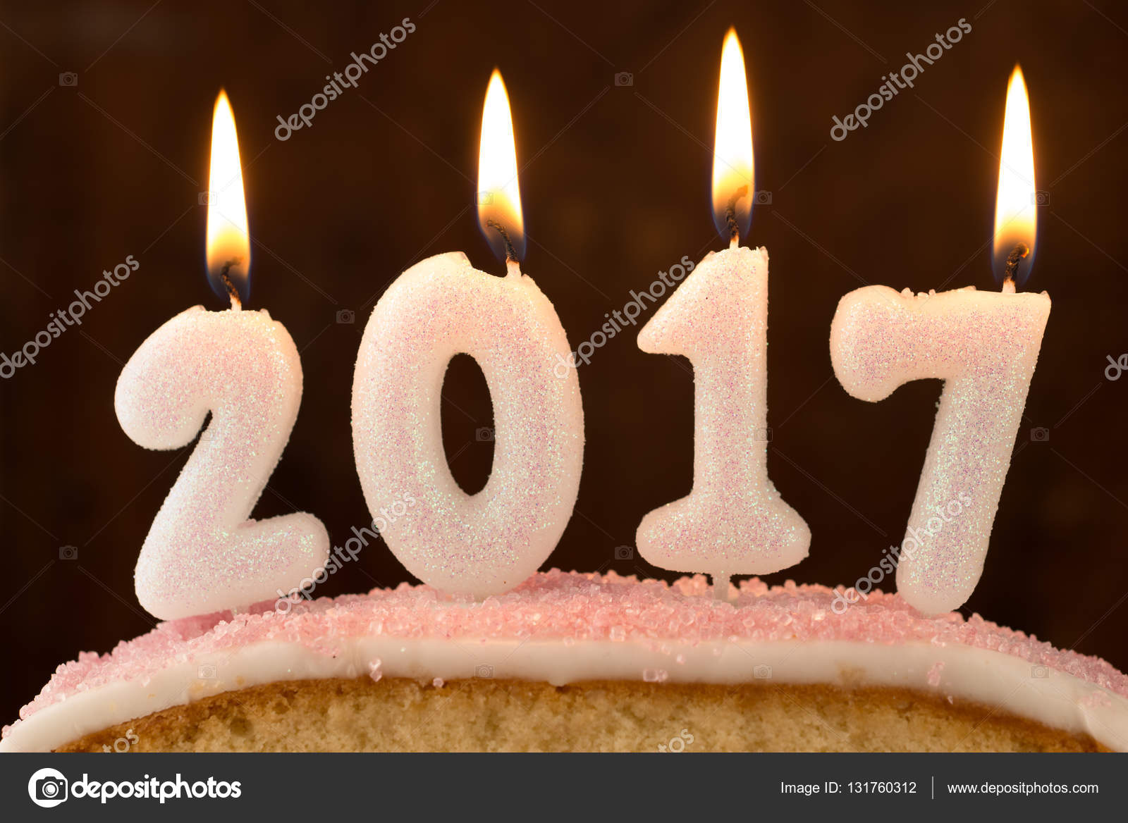 4 White Candles 2017 Lit On Top Of A Sponge Cake Shot Close Up Against Dark Wooden Background Photo By Stockphotographyfirmcouk