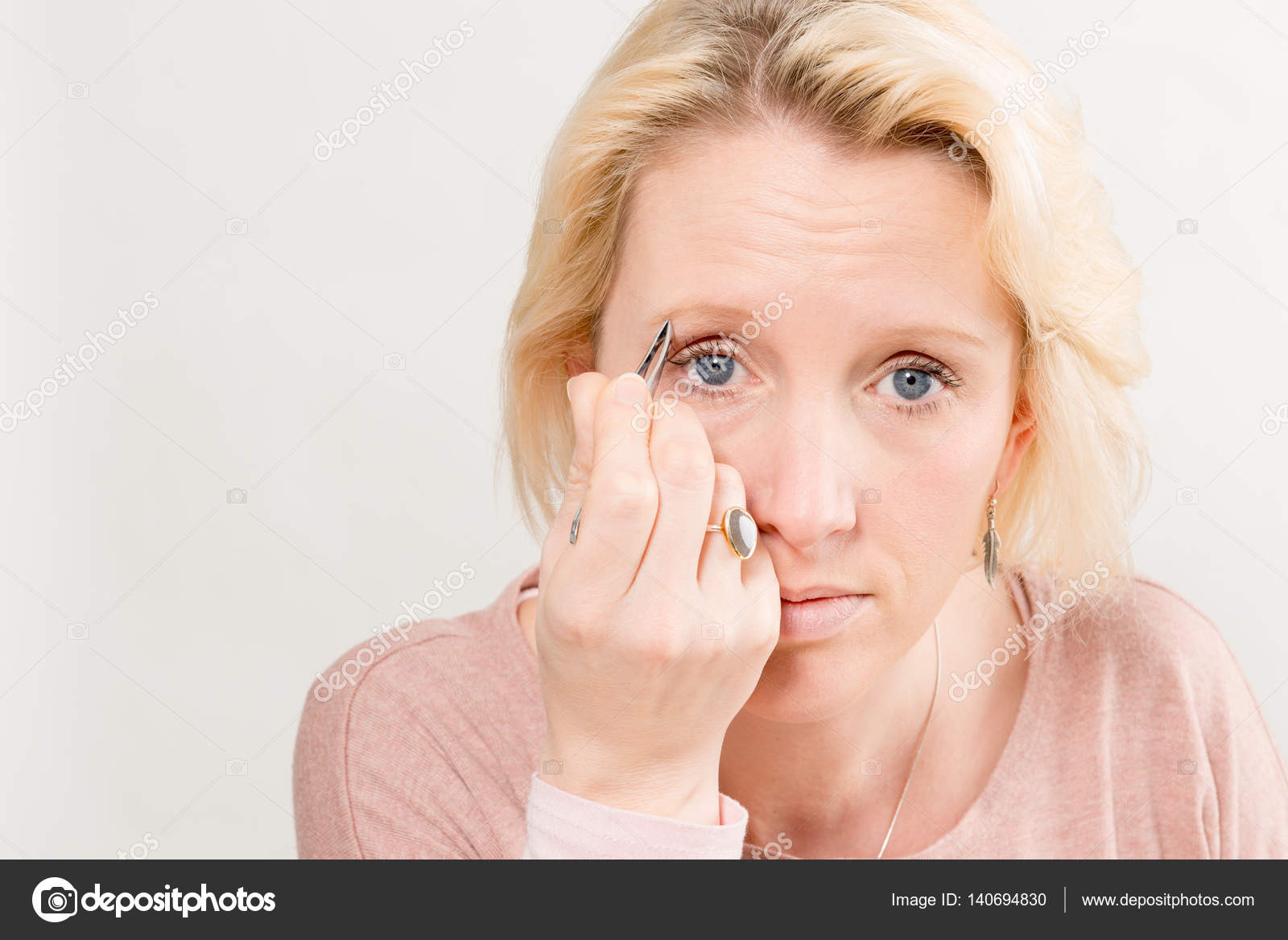 Woman Plucking Eyebrows With Copy Space Stock Photo Stock
