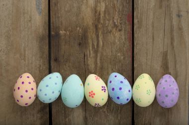 Banner Photo Hand-Painted Easter Eggs Over Wooden Background