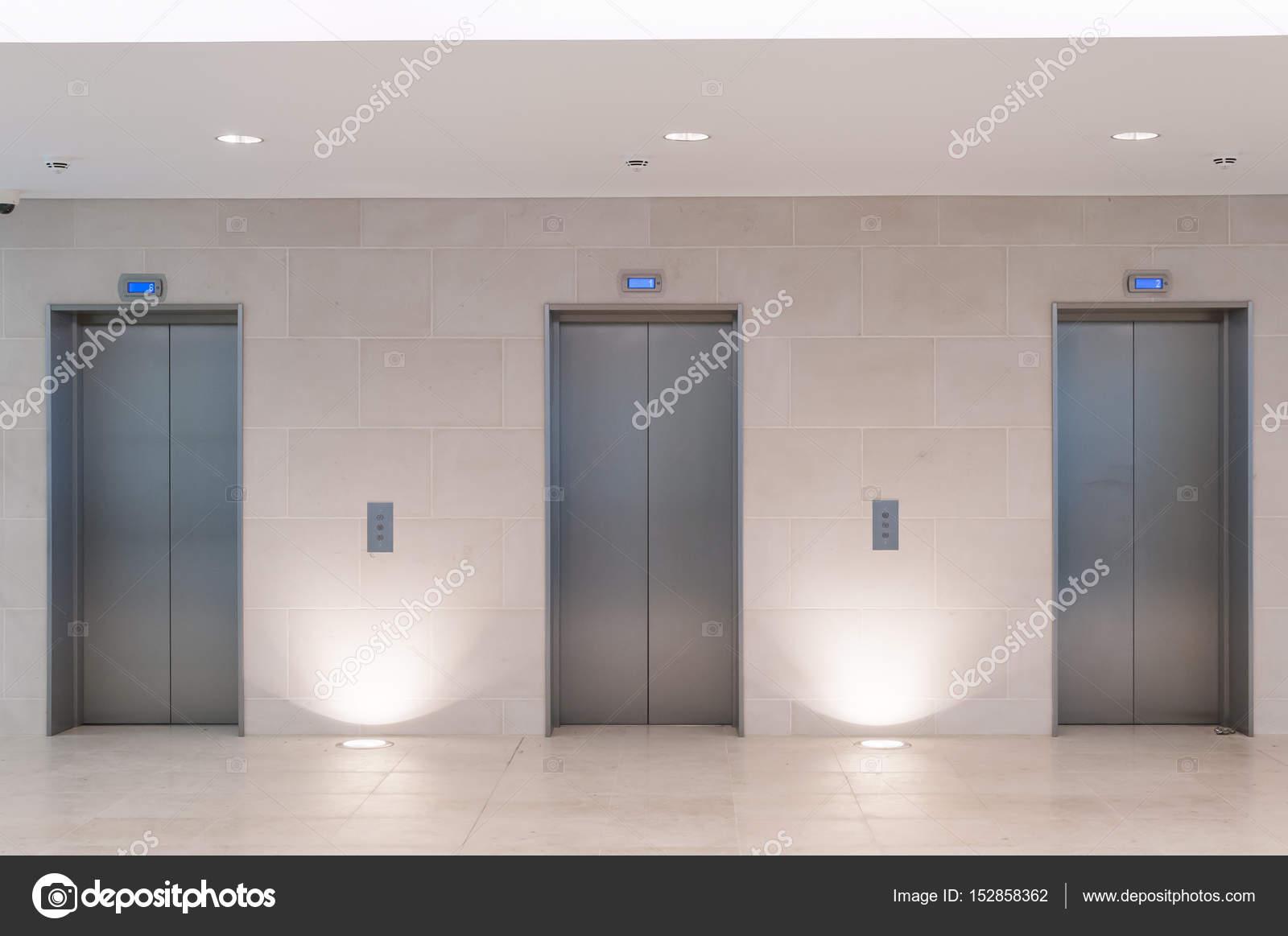 Three lift doors in office building \u2014 Stock Photo & Three lift doors in office building \u2014 Stock Photo © stock ...