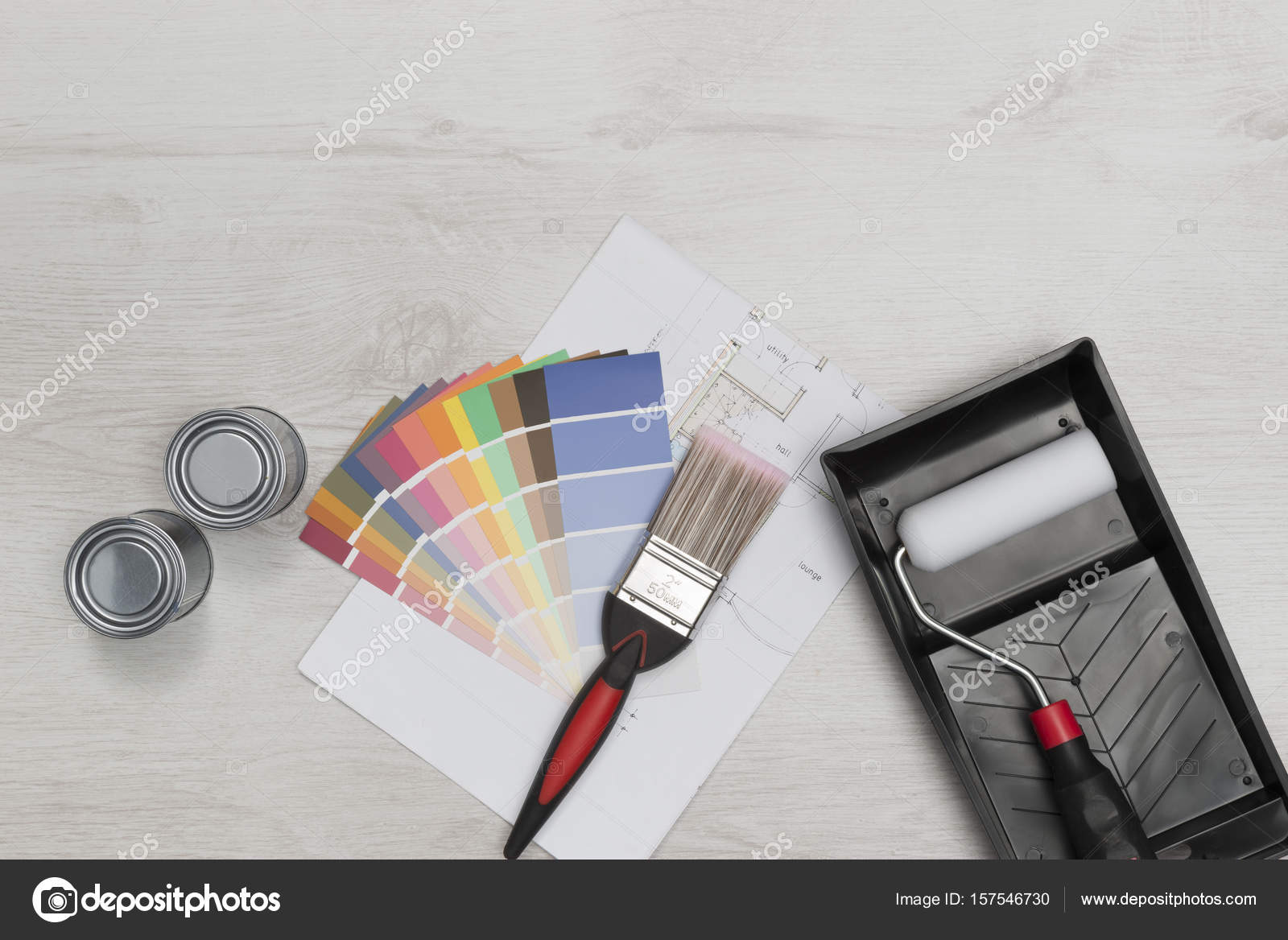 Paintbrush roller swatches cans of paint and blueprints over paintbrush roller swatches cans of paint and blueprints over stock photo malvernweather Images