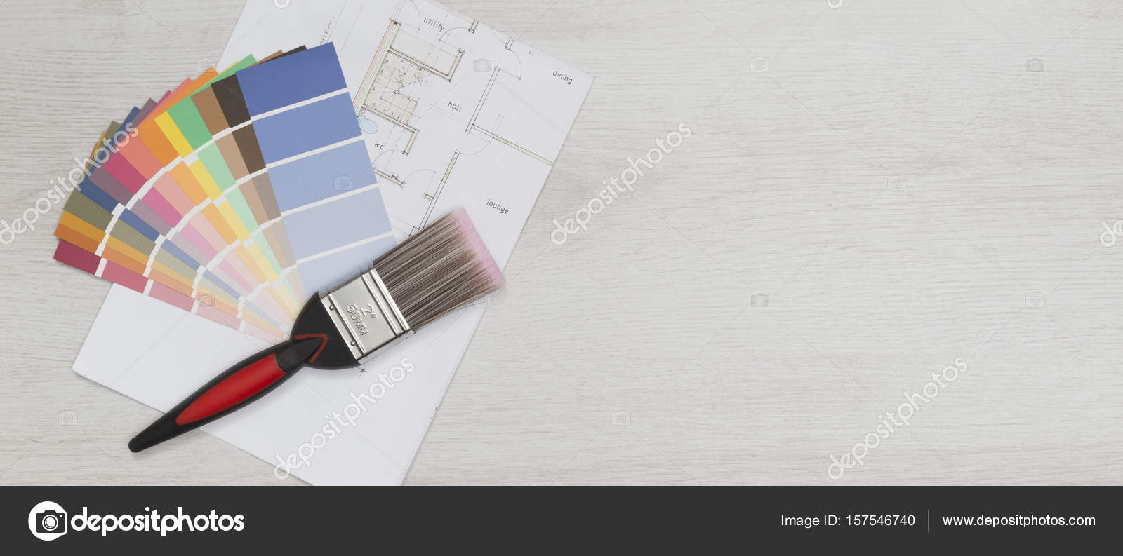 Paintbrush and paint swatches on blueprint with copy space stock paintbrush and paint swatches on blueprint with copy space stock photo 157546740 malvernweather Gallery