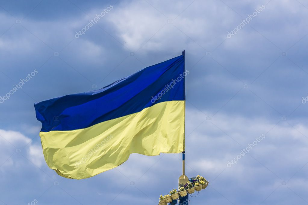 The national yellow and blue flag of Ukraine over the sky  clouds