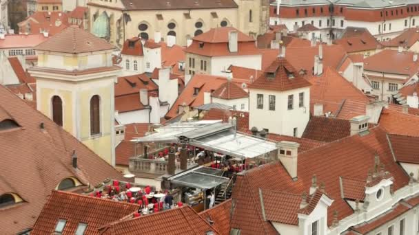 The gothic red tile roofs of medieval buildings and towers  in Prague in autumn