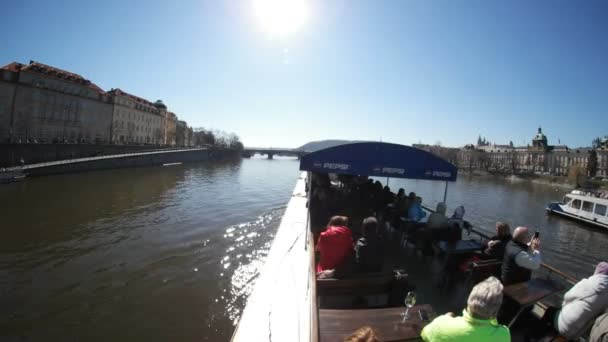 Prague, Czech Republic - March 24, 2017:Motorboat with tourists goes towards an impressive sunset on the Vltava river