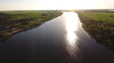 Aerial shot of the Dnipro river and its picturesque riverbanks at sunset