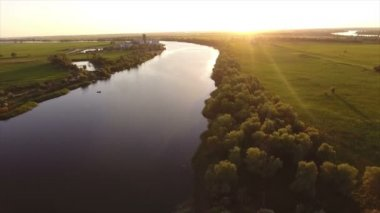 Aerial shot of the Dnipro river and its splendid riverbanks at sunset