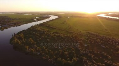 Aerial shot of a curvy turn of the Dnipro river with high trees on its banks