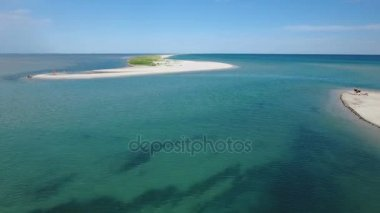 Aerial shot of a beautiful small island on a shoal of the Black Sea in summer