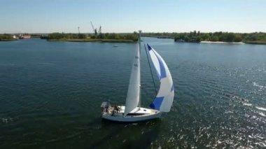 Nikolaev, Ukraine - September 16, 2017:Aerial shot of a beautiful white yacht sailing along the Dnipro in summer
