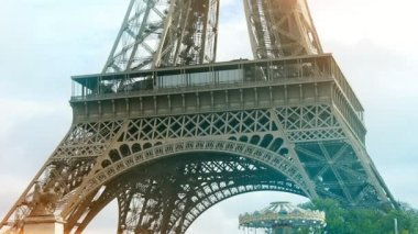 The Eiffel Tower, the dream of world tourists, looks magic in autumn in slo-mo                                   An amazing view of the Eiffel Tower made of wrought lattice iron in the 19th century. It looks great in the blue sky background in slo-mo