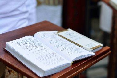 JERUSALEM, ISRAEL - APRIL 2017:  Talmud Tora Tanach Books lying on table during prayer in Bar Mitzwa Ceremony at the Western Wall Jerusalem (Kotel)