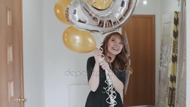 Excited surprised woman with colorful balloons in slow motion