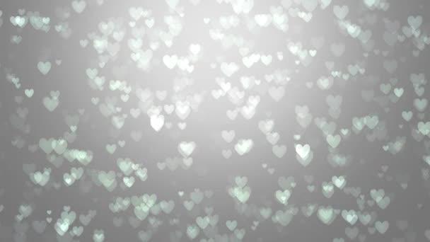 Animáció a szürke alapon fehér szívek