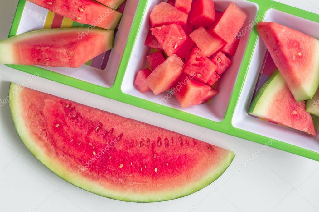 Watermelon cuts and slices in serving platter on white backgroun