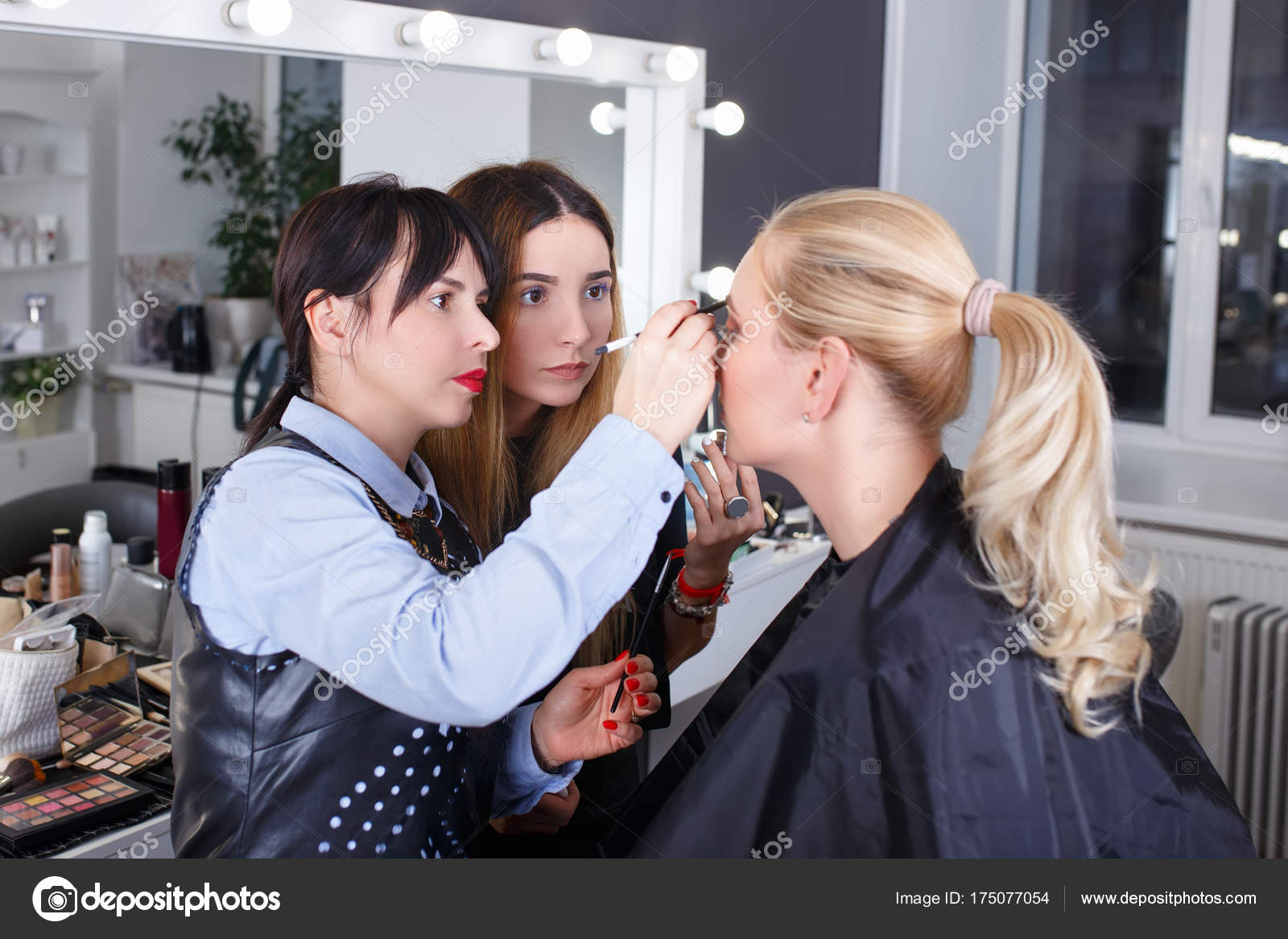 Makeup tutorial lesson at beauty school stock photo alterphoto makeup teacher with her student girl makeup tutorial lesson at beauty school make up artist work in her studio portrait of visagist applying makeup on baditri Image collections