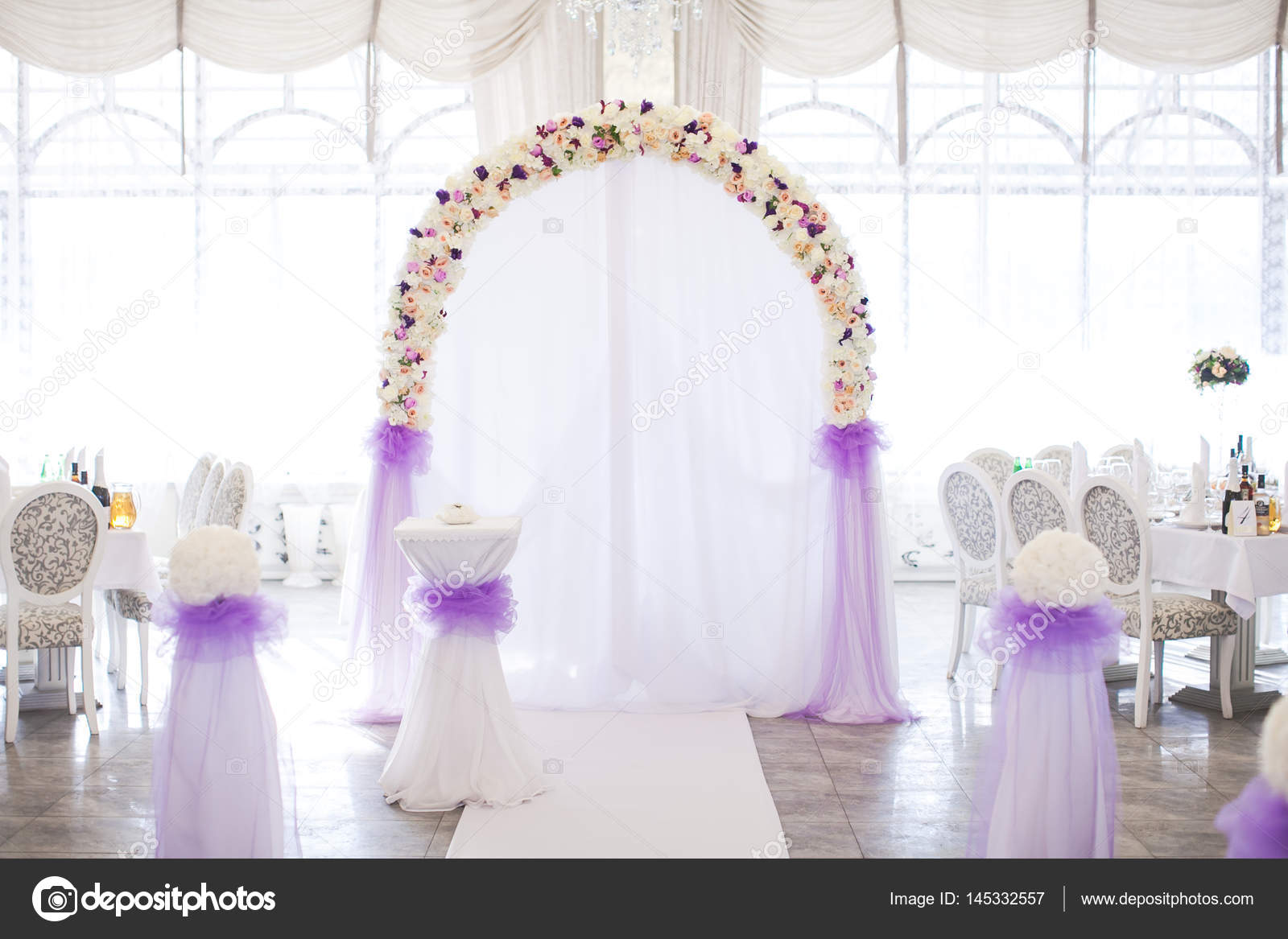 flower arch from fresh colors for a wedding ceremony at restaurant ...