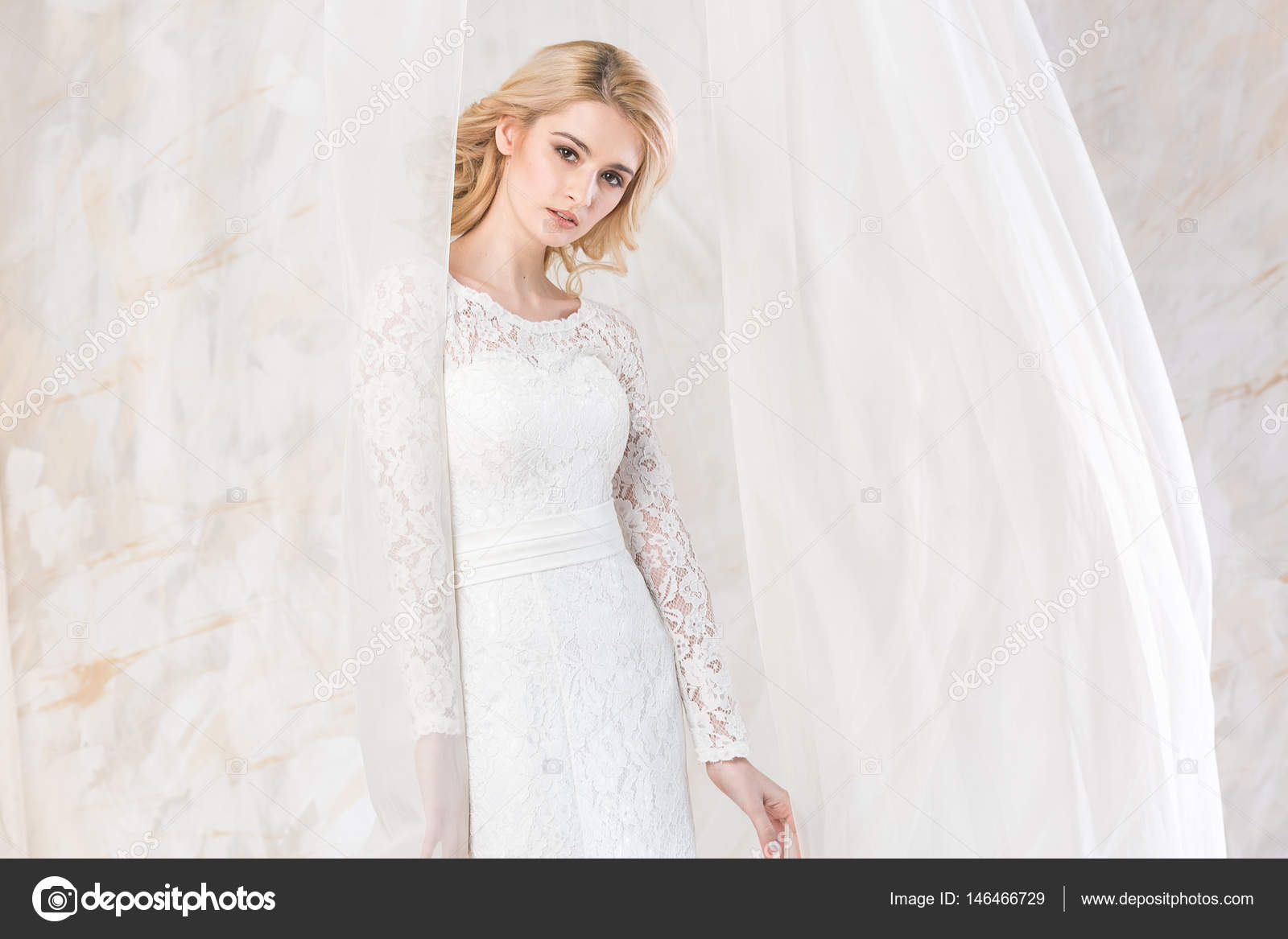 Portrait of the gorgeous thoughtful blonde bride with beautiful ...