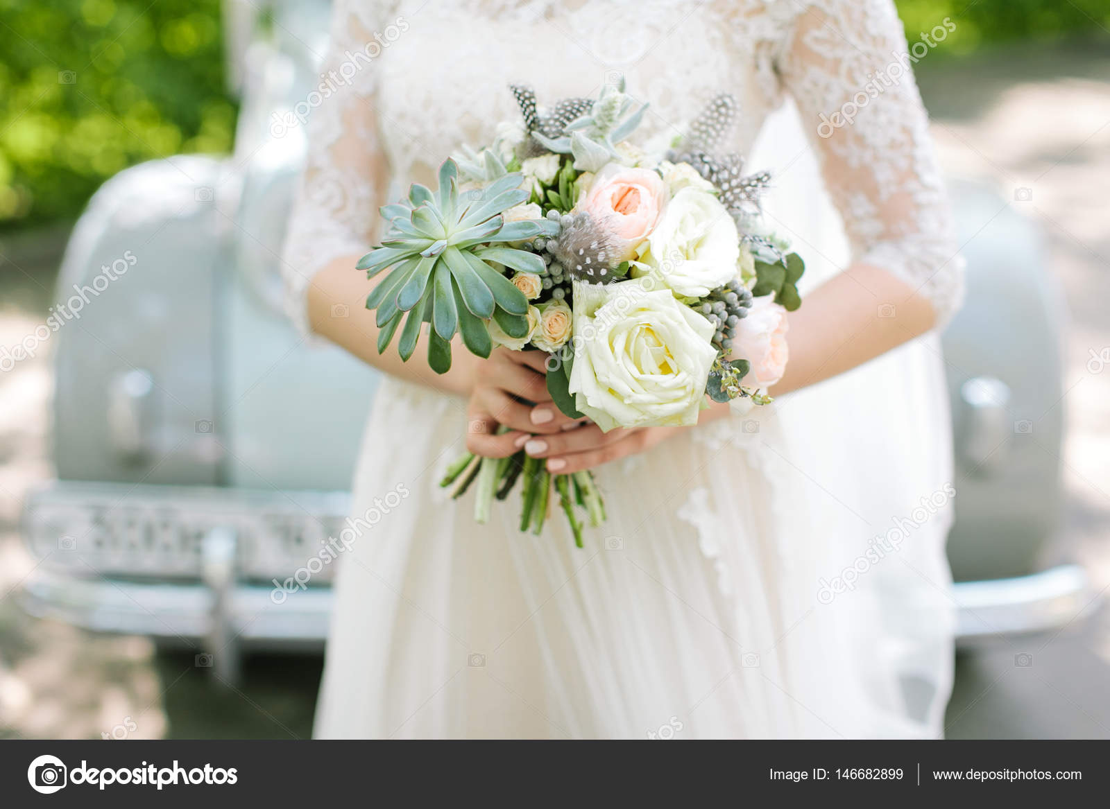 Beautiful Woman In A White Wedding Dress Holding A Flowers Bouquet