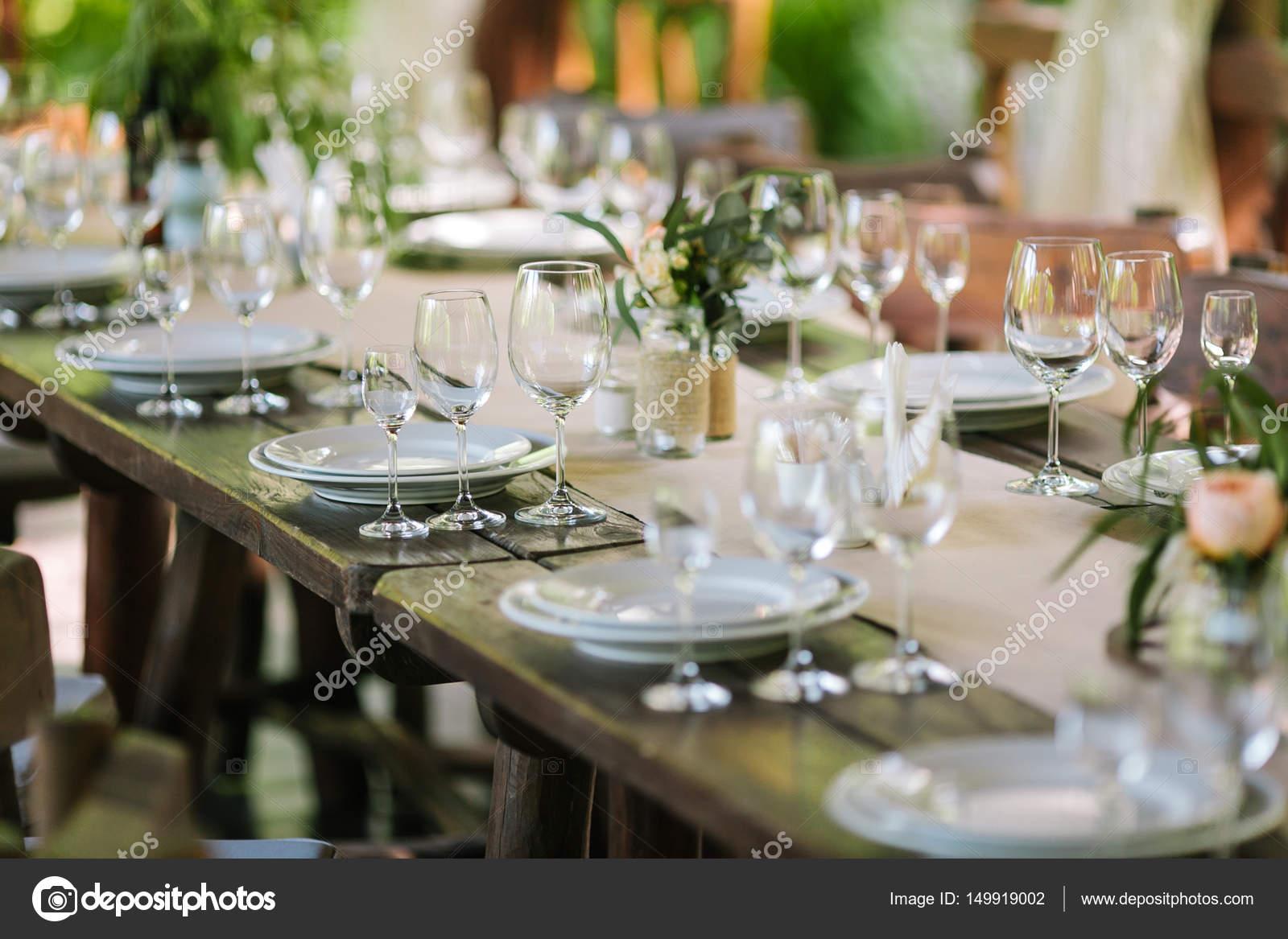 Glasses on the festive table setting. Wedding table decor. Table ...