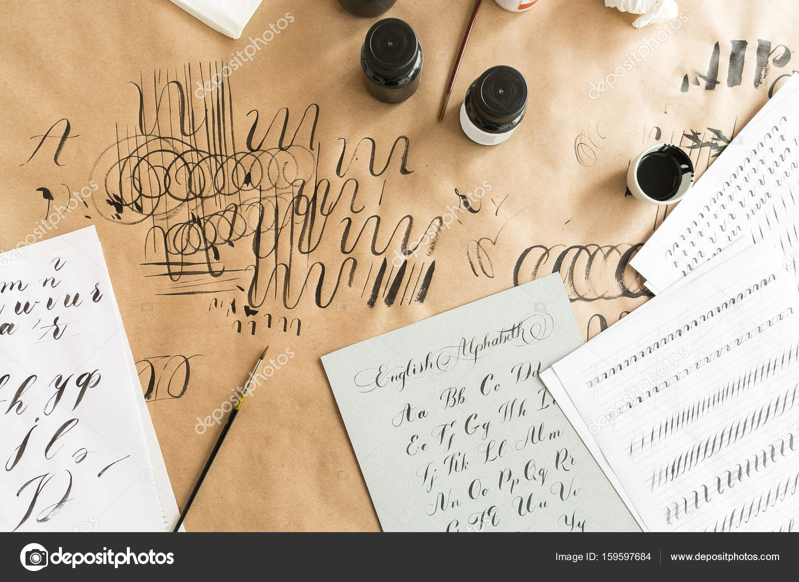 Hand drawn latin calligraphy of brush script. calligraphical letters