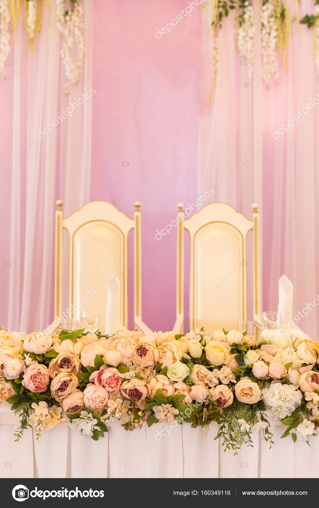 Festive Table For The Bride And Groom Decorated With Pink Cloth And