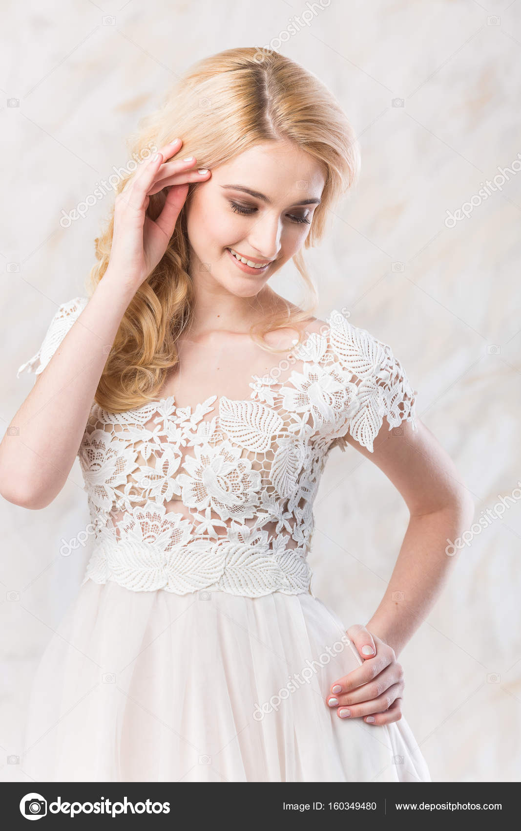 wedding dress, beautiful blonde model, bride hairstyle and makeup ...