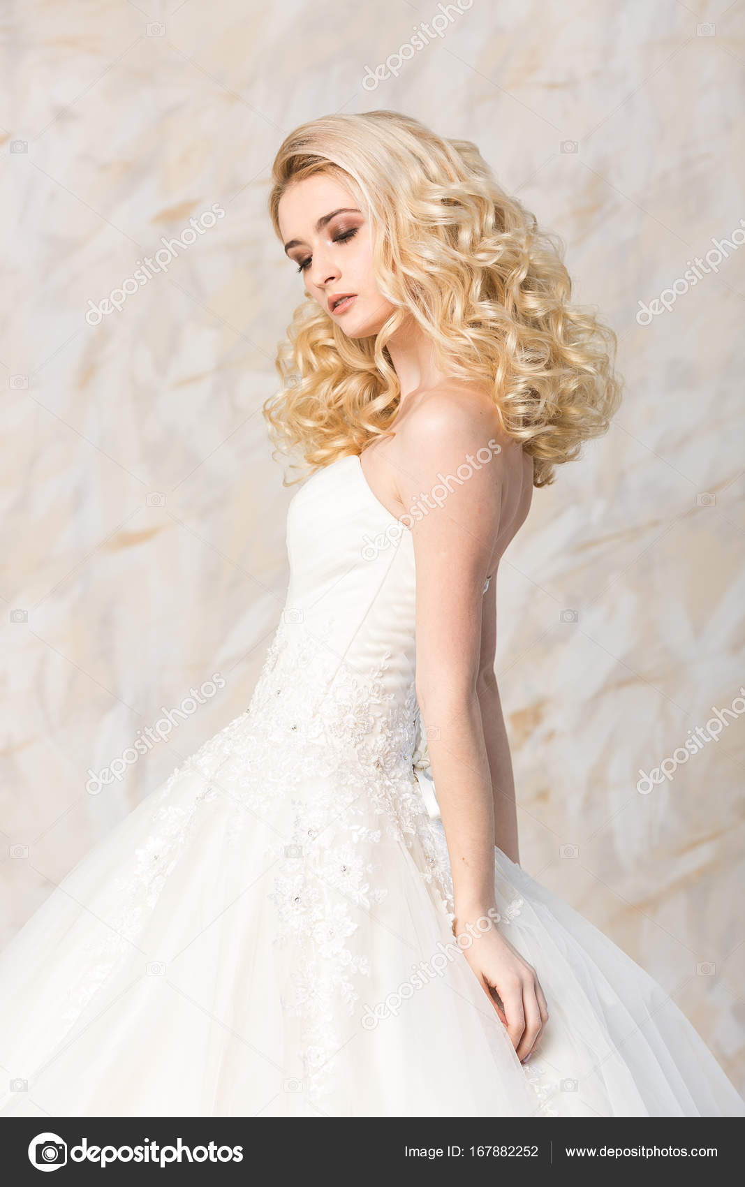 fashionable gown, beautiful blonde model, bride hairstyle and makeup ...