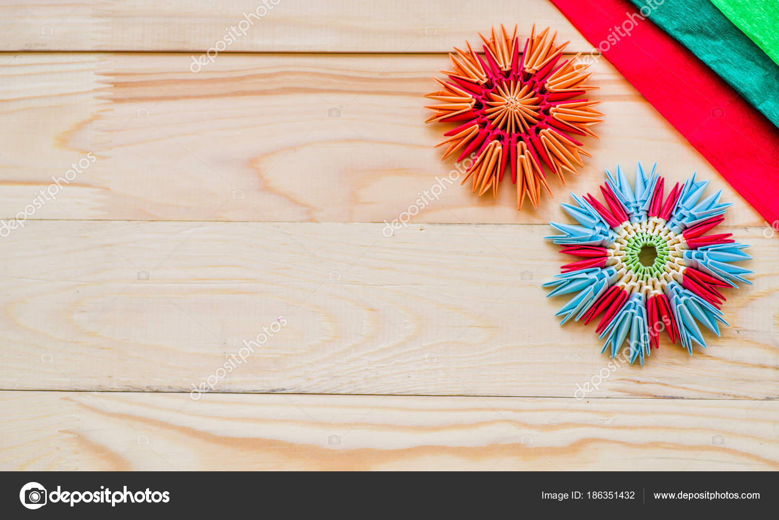 Modular Origami Flowers On Rustic Wooden Background With Paper