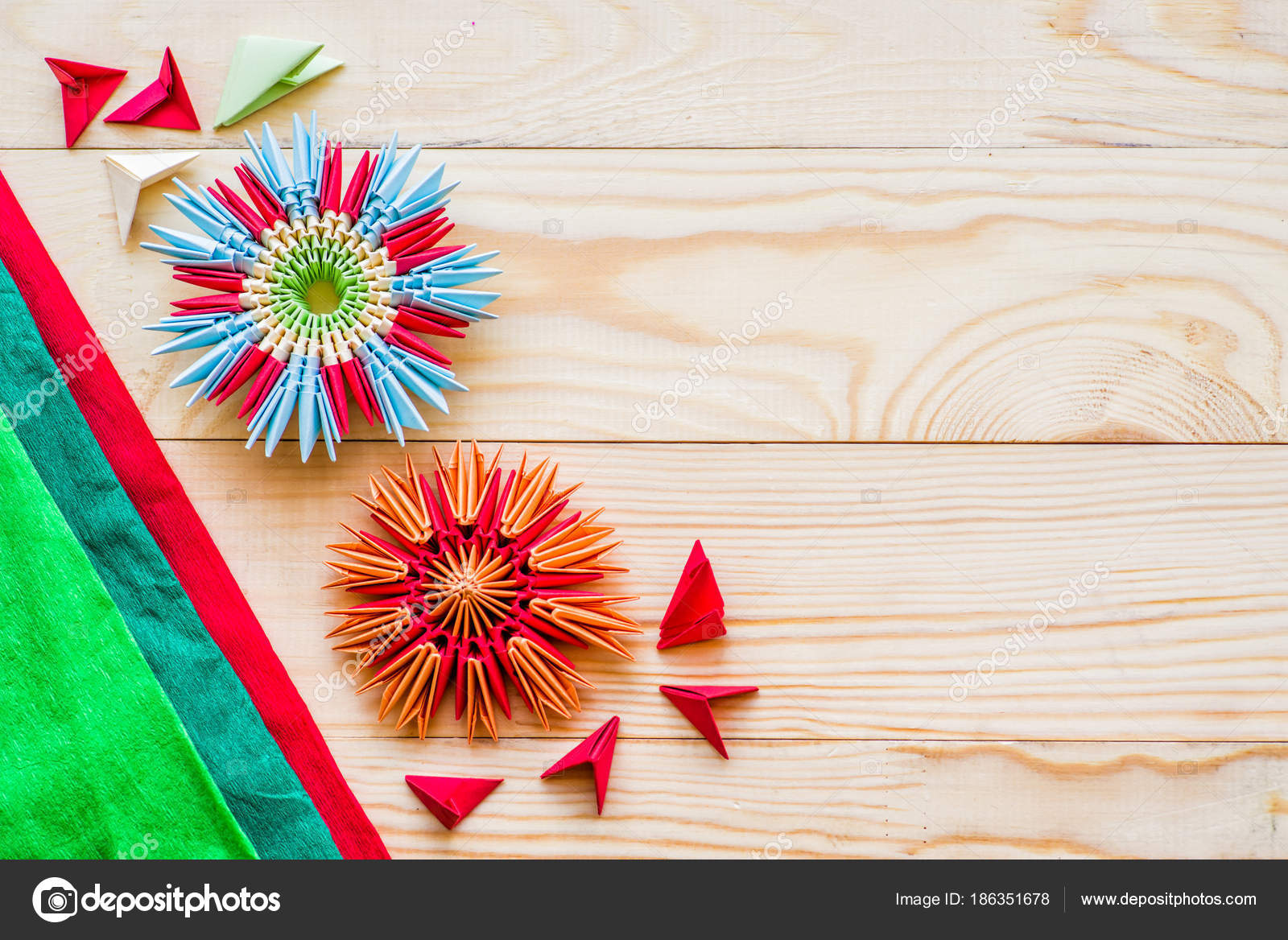 Modular Origami Flowers On Rustic Wooden Background With Paper And