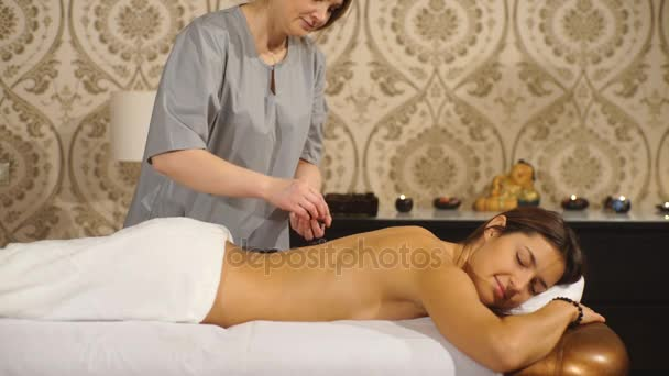Girl On A Stone Therapy Hot Stone Massage Stock Video