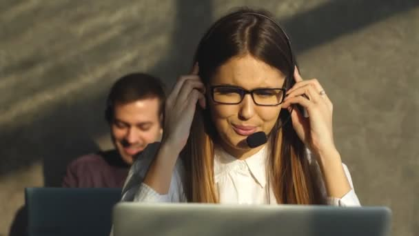 Side view of young call center agents at work