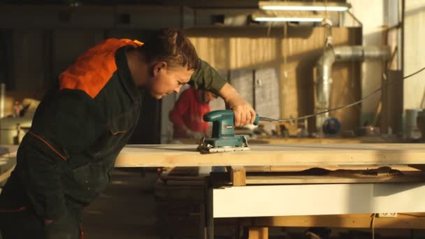 male joinery worker smoothening piece of wood