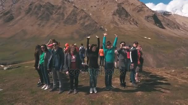 the group of travelers in the mountains are in the circle